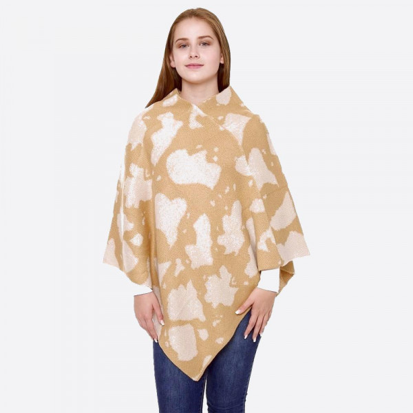 "Cow print knit poncho.   - One size fits most 0-14 - Approximately 32"" L - 100% Acrylic"