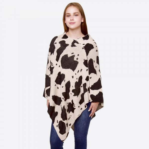"""Cow Print Knit Poncho.  - One size fits most 0-14 - Approximately 32"""" L - 100% Acrylic"""