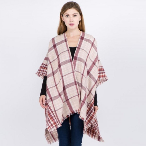 "Plaid print ruana with frayed edges.  - One size fits most 0-14 - Approximately 32"" L - 100% Acrylic"