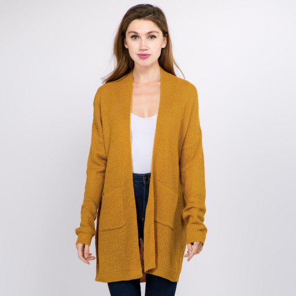 """Solid color thin knit cardigan with front pocket details.  - One size fits most 0-14 - Approximately 29"""" in length  - 100% Acrylic"""