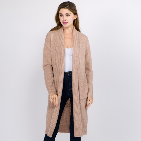 """Long solid color soft touch knit cardigan with front pocket details.  - One size fits most 0-14 - Approximately 36"""" in length - 70% Acrylic, 27% Polyamide, 3% Spandex"""