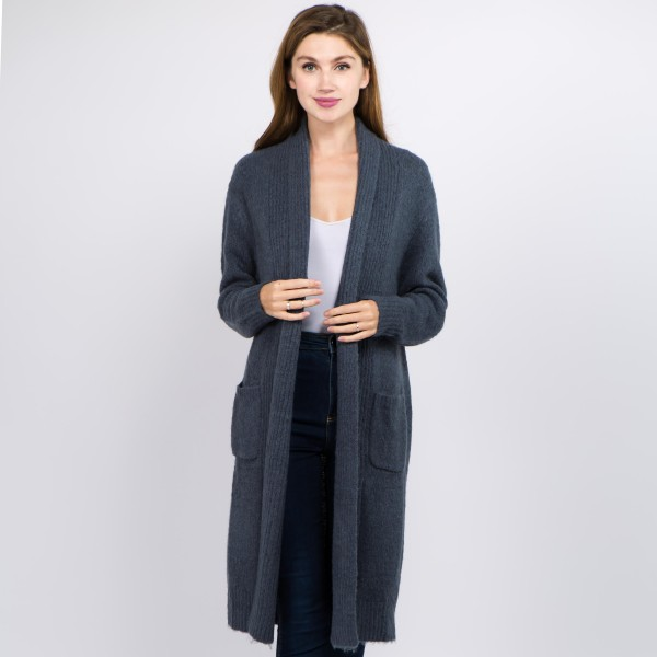 """Solid color soft touch knit long cardigan with front pocket details.  - One size fits most 0-14 - Approximately 36"""" in length - 70% Acrylic, 27% Polyamide, 3% Spandex"""