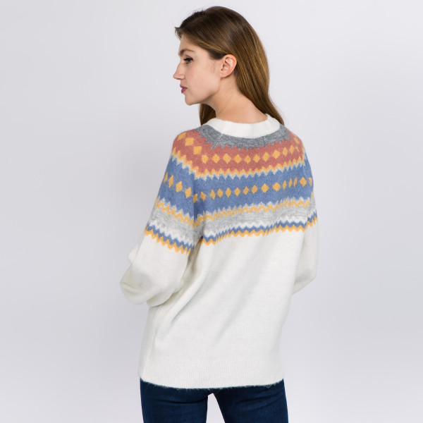 """Soft touch fuzzy knit geo print sweater.  - One size fits most 0-14 - Approximately 25"""" in length - 66% Acrylic, 30% Polyester, 4% Spandex"""