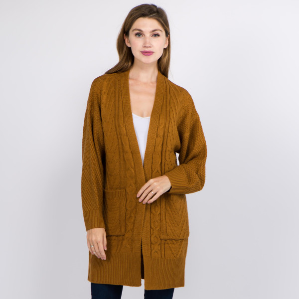 """Solid color cable knit knitted cardigan with front pocket details.  - One size fits most 0-14 - Approximately 32"""" in length - 100% Acrylic"""