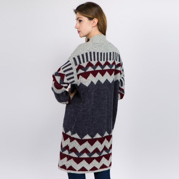 """Long geo print knit cardigan.  - One size fits most 0-14 - Approximately 35"""" in length - 72% Acrylic, 20% Nylon, 8% Spandex"""