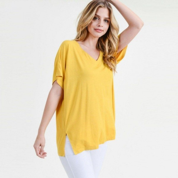 "Ladies Solid Color Short Sleeve Oversized Tee with Side Slit Details.  • Short sleeves, v-neck  • Oversized silhouette  • Side slit accents  • Soft and stretchy  • Pullover styling   • Soft and stretchy  • Imported   - Pack Breakdown: 6pck/pack - Sizes: 2-S / 2-M / 2-L - Approximately 25"" L - 95% Rayon / 5% Spandex"
