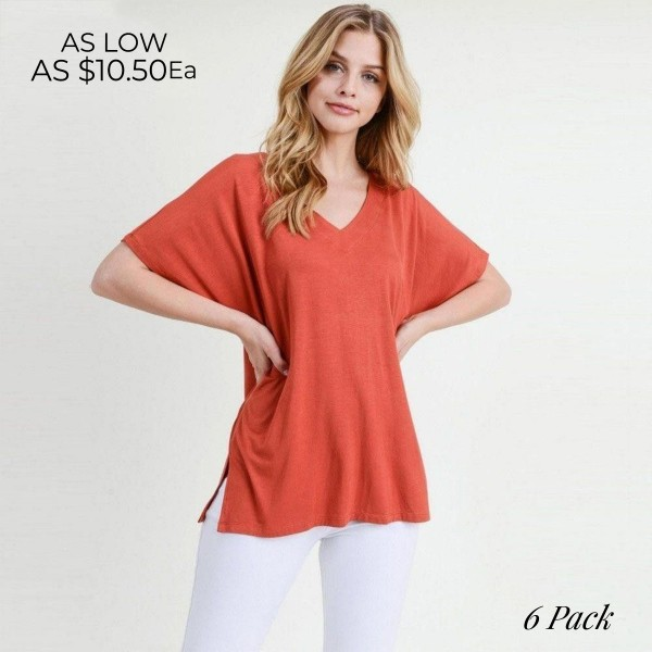 "Ladies Solid Color Short Sleeve Oversized Tee with Side Slit Details. (6 Pack)  • Short sleeves, v-neck  • Oversized silhouette  • Side slit accents  • Soft and stretchy  • Pullover styling   • Soft and stretchy   - Pack Breakdown: 6pck/pack - Sizes: 2-S / 2-M / 2-L - Approximately 25"" L - 95% Rayon / 5% Spandex"