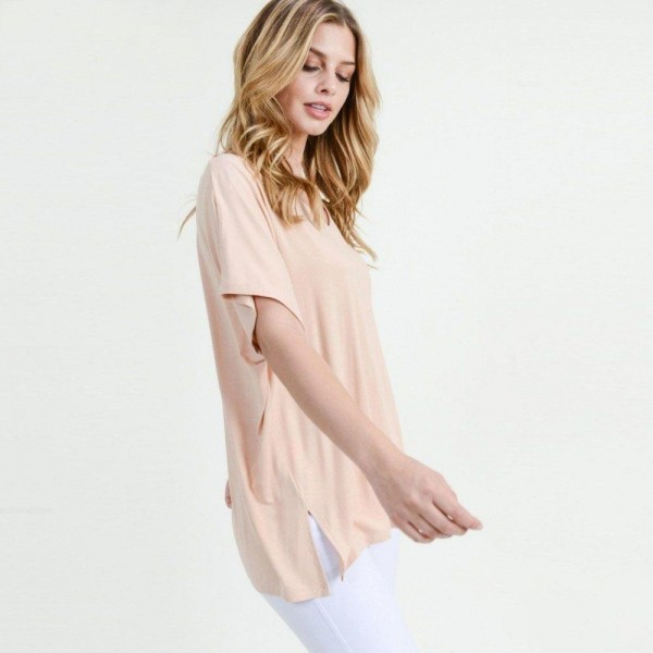 """Ladies Solid Color Short Sleeve Oversized Tee with Side Slit Details.  • Short sleeves, v-neck  • Oversized silhouette  • Side slit accents  • Soft and stretchy  • Pullover styling   • Soft and stretchy  • Imported   - Pack Breakdown: 6pck/pack - Sizes: 2-S / 2-M / 2-L - Approximately 25"""" L - 95% Rayon / 5% Spandex"""