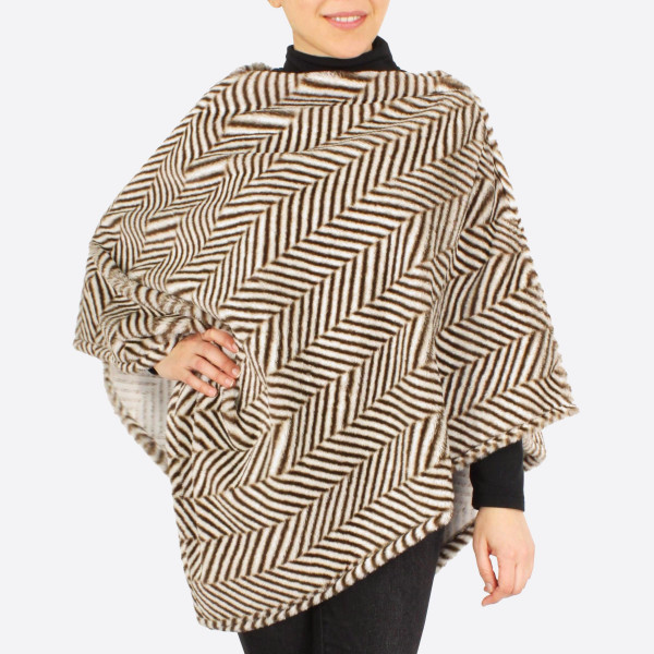 "Faux Fur Herringbone Poncho.  - One size fits most 0-14 - Approximately 36"" L - 100% Polyester"