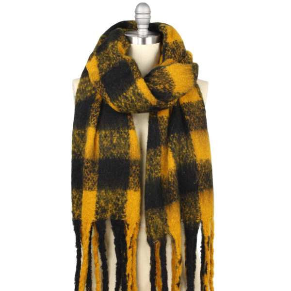 """Oversized Oblong Buffalo Check Scarf Featuring Fringe Tassels.  - Approximately 19.5"""" W x 70.5"""" L  - Fringes 5.5"""" L - 100% Polyester"""