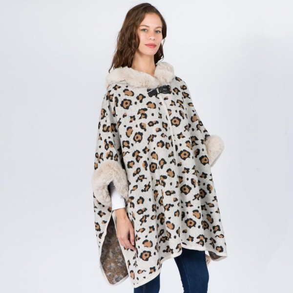 "Faux fur trim leopard print cape/ruana.  - One size fits most 0-14 - Approximately 32"" in length - 100% Acrylic"