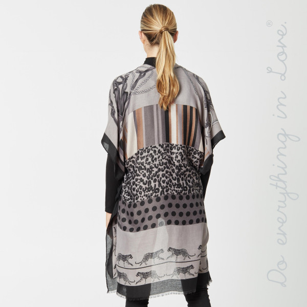 """Do everything in Love Brand Multi Animal Print Kimono.  - One size fits most 0-14 - Approximately 36"""" L - 100% Viscose"""