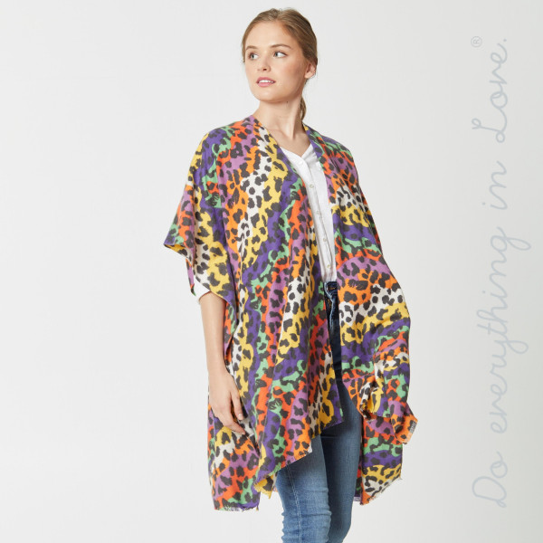"""Do everything in Love Brand Lightweight Multicolor Leopard Print Kimono.  - One size fits most 0-14 - Approximately 37"""" L - 100% Viscose"""