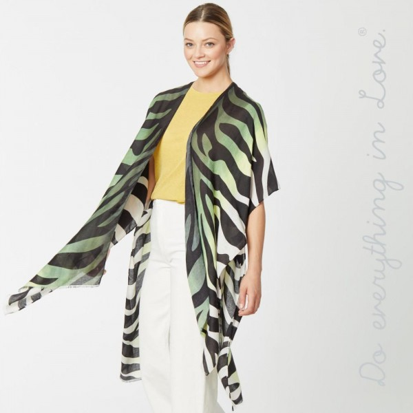 "Do everything in Love brand lightweight ombre zebra print kimono.  - One size fits most 0-14 - Approximately 36"" in length - 100% Polyester"
