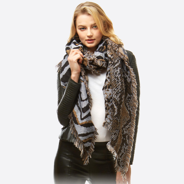 """Multi animal print bias oblong scarf with frayed edges.  - Approximately 27"""" W x 51"""" L - 100% Acrylic"""