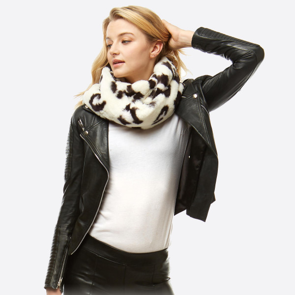 "Faux Fur Leopard Print Infinity Scarf.  - Approximately 8"" W x 60"" L - 100% Polyester"
