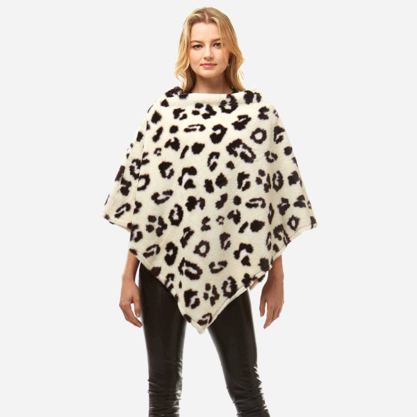 "Women's Faux Fur Leopard Print Poncho.  - One size fits most 0-14 - Approximately 32"" L - 100% Polyester"