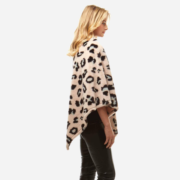 "Faux Fur Leopard Print Poncho.  - One size fits most 0-14 - Approximately 32"" L - 100% Polyester"