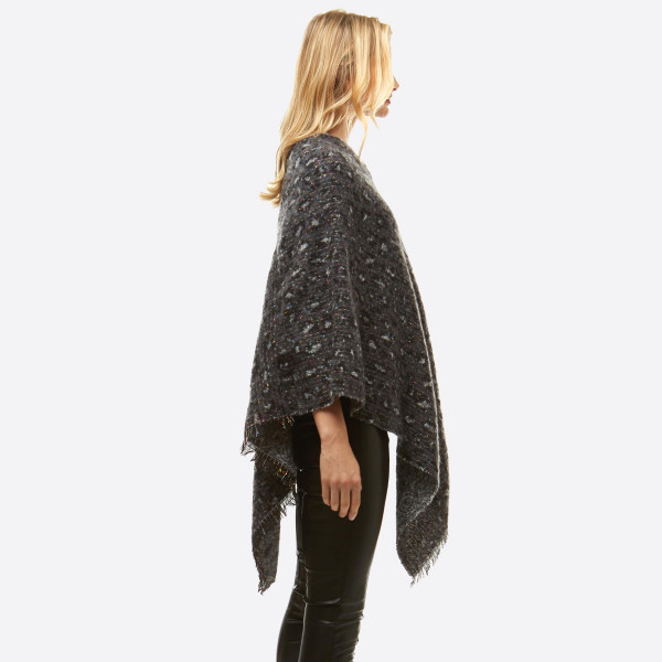 "Soft touch leopard print metallic confetti string poncho with frayed edges. The metallic thread gives this poncho a glimmering, glittering look with a slight rainbow sheen.   - One size fits most 0-14 - Approximately 36"" in length - 100% Polyester"