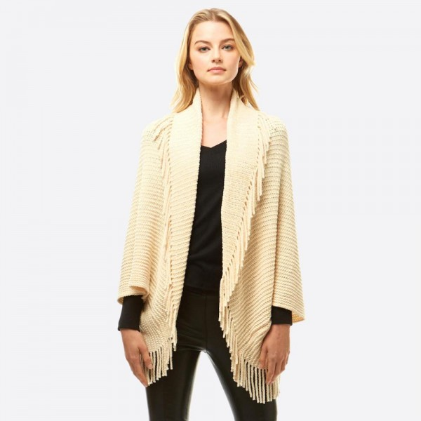 "Women's Solid Color Chenille Knit Shrug/Shawl Featuring Tassel Trim.  - One size fits most 0-14 - Approximately 36"" L - 100% Polyester"