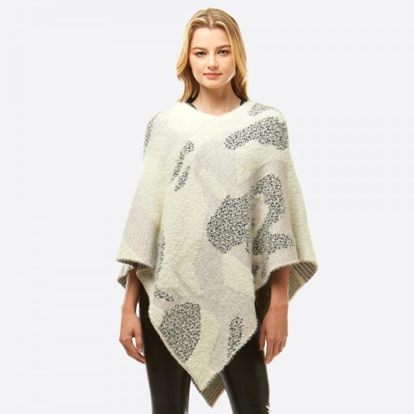 """Chenille Knit Abstract Print Poncho.  - One size fits most 0-14 - Approximately 25.5"""" L - 60% Nylon, 40% Acrylic"""