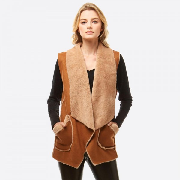 "Faux Fur Lined Suede Vest Featuring Pockets.  - One size fits most 0-14 - Approximately 29"" L - 100% Polyester"