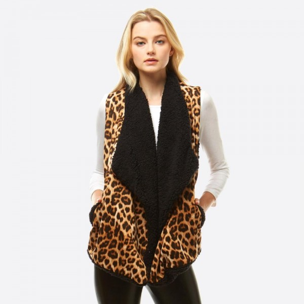 """Sherpa Lined Leopard Print Vest Featuring Pockets.  - One size fits most 0-14 - Approximately 25"""" L - 100% Polyester"""