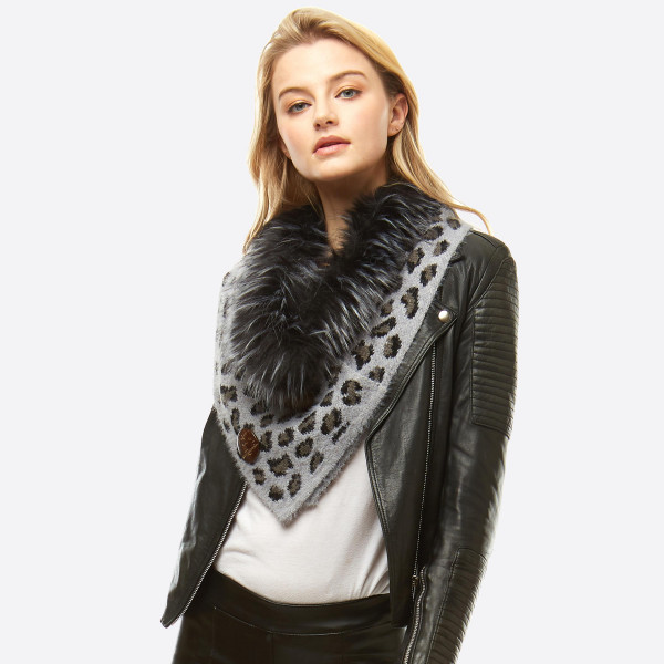 "Leopard Print Knit Scarf/Shawl Featuring Faux Fur Neck Trim and Coconut Button Details.  - Front approximately 17"" W x 15"" L  - Back approximately 17"" W x 8"" L - 50% Acrylic, 50% Nylon"
