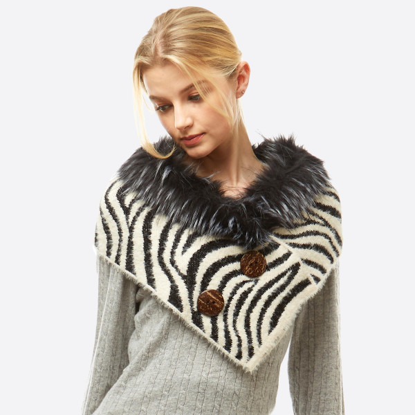 "Zebra Print Knit Shawl/Scarf Featuring Faux Fur Neck Trim and Coconut Button Details.  - Front approximately 17"" W x 15"" L  - Back approximately 17"" W x 8"" L  - 50% Acrylic, 50% Nylon"