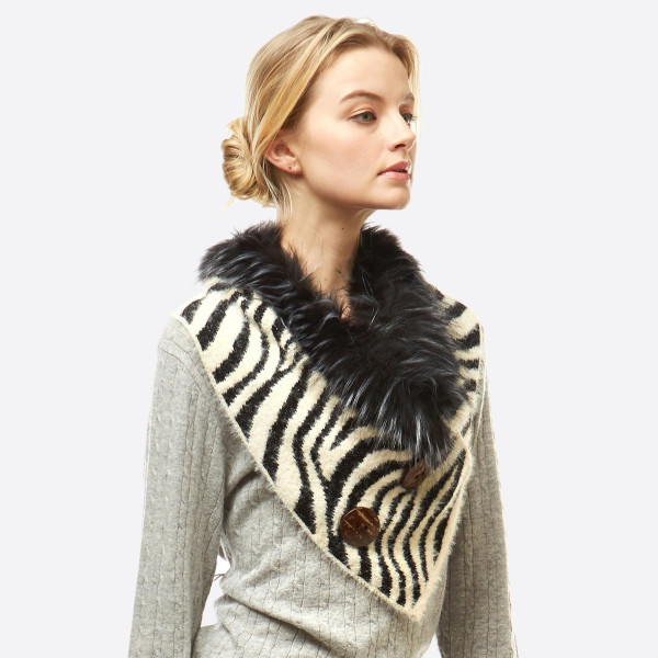 """Zebra Print Knit Shawl/Scarf Featuring Faux Fur Neck Trim and Coconut Button Details.  - Front approximately 17"""" W x 15"""" L  - Back approximately 17"""" W x 8"""" L  - 50% Acrylic, 50% Nylon"""