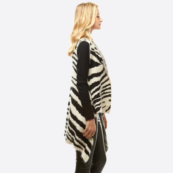 """Fuzzy Knit Zebra Print Vest.  - One size fits most 0-14 - Approximately 28"""" L - 100% Acrylic"""