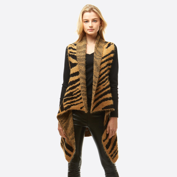 "Fuzzy zebra print vest.  - One size fits most 0-14 - Approximately 28"" in length - 100% Acrylic"