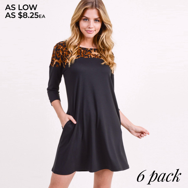 "Women's Black A-Line Tunic Dress Featuring Leopard Print Shoulder Detail. (6 PACK)  • 3/4 length sleeves  • Round neckline  • Cheetah print detail on shoulder  • Two side seam pockets to keep hands warm  • A-line silhouette  • Above the knee length hem  • Soft and comfortable fabric with stretch  • Imported   - Pack Breakdown: 6pcs / pack - Sizes: 2-S / 2-M / 2-L - Approximately 34"" L  - 95% Polyester, 5% Spandex"