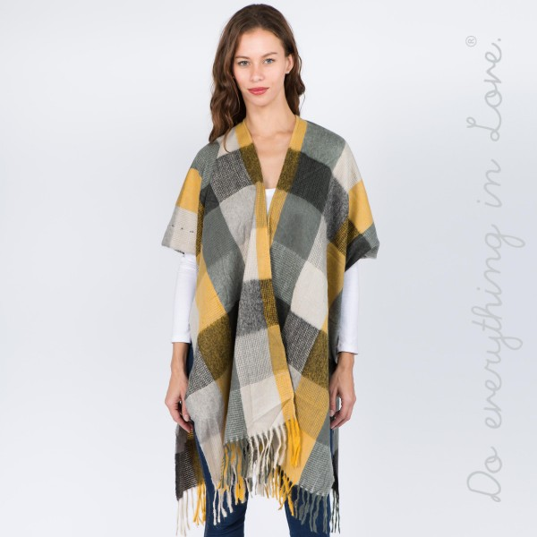 "Do everything in Love Brand Multi Checkered Kimono with Fringe Tassels.  - One size fits most 0-14 - Approximately 37"" L - 100% Polyester"