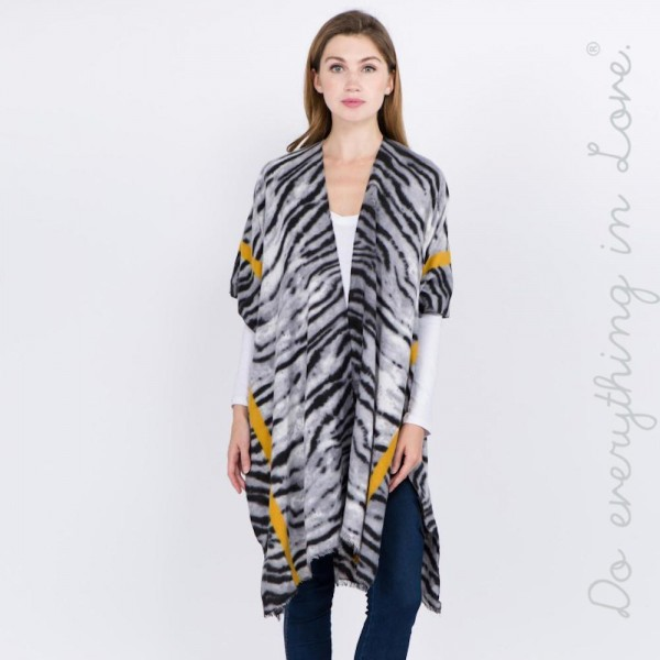 "Do everything in Love brand soft touch bordered stipe tiger print kimono.  - One size fits most 0-14 - Approximately 37"" L - 100% Viscose"