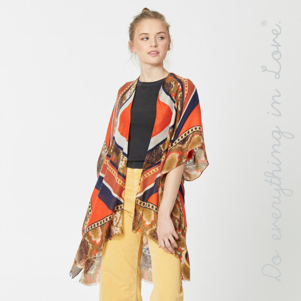 "Do everything in Love brand lightweight designer inspired kimono.  - One size fits most 0-14 - Approximately 36"" in length - 100% Viscose"