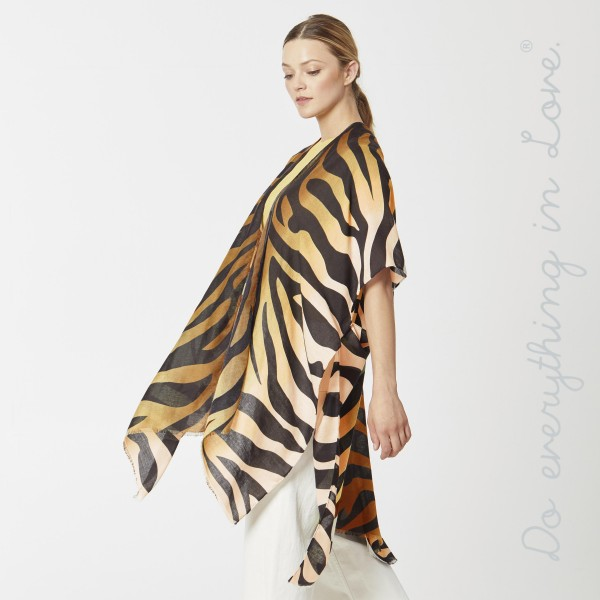 "Do everything in Love Brand Lightweight Ombre Zebra Print Kimono.  - One size fits most 0-14 - Approximately 36"" L - 100% Polyester"