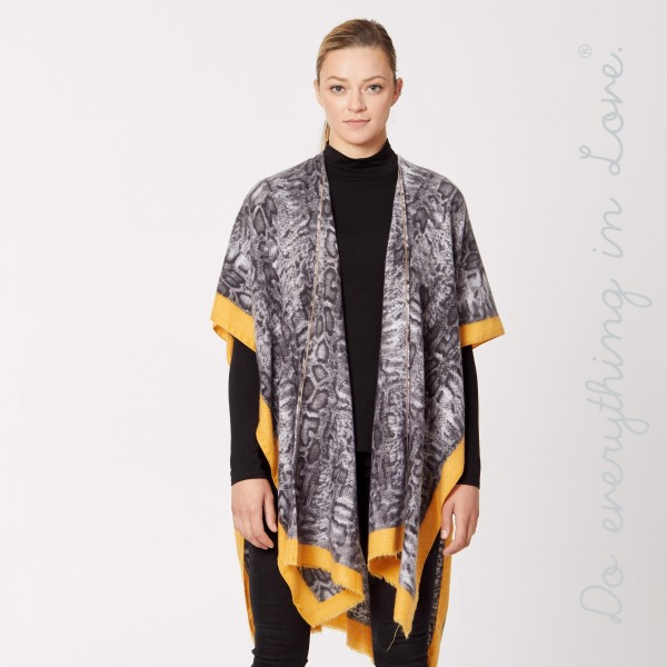 "Do everything in Love brand cozy snakeskin print bordered kimono.   - One size fits most 0-14 - Approximately 37"" L - 80% Polyester, 20% Viscose"