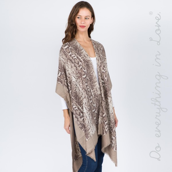"""Do everything in Love Brand Bordered Snakeskin Kimono.  - One size fits most 0-14 - Approximately 37"""" L - 70% Polyester, 30% Viscose"""