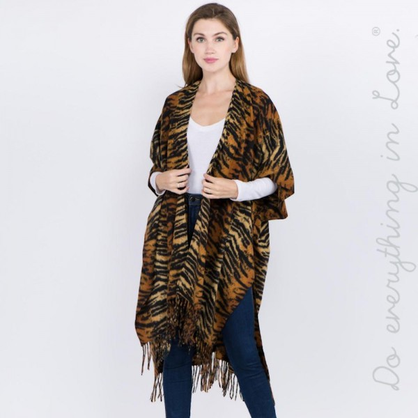 "Do everything in Love brand soft touch tiger stripe ruana with fringes.  - One size fits most 0-14 - Approximately 42"" L - 70% Polyester, 30% Viscose"