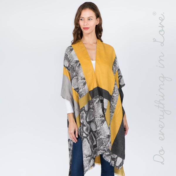 "Do everything in Love brand snakeskin color block kimono.  - One size fits most 0-14 - Approximately 37"" L - 70% Polyester, 30% Viscose"