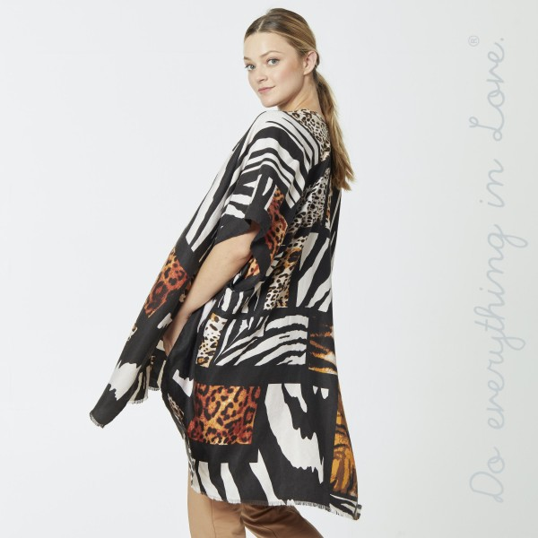 """Do everything in Love Brand Lightweight Multi-Animal Print Kimono.  - One size fits most 0-14 - Approximately 37"""" L - 100% Polyester"""