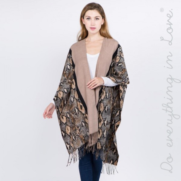 """Do everything in Love Brand Snakeskin Bordered Ruana Featuring Fringe Tassels.  - One size fits most 0-14 - Approximately 40"""" L - 70% Polyester, 30% Viscose"""
