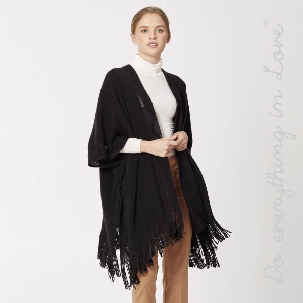 "Do everything in Love brand textured bordered woven kimono with fringes.  - One size fits most 0-14 - Approximately 33"" L - 100% Acrylic"