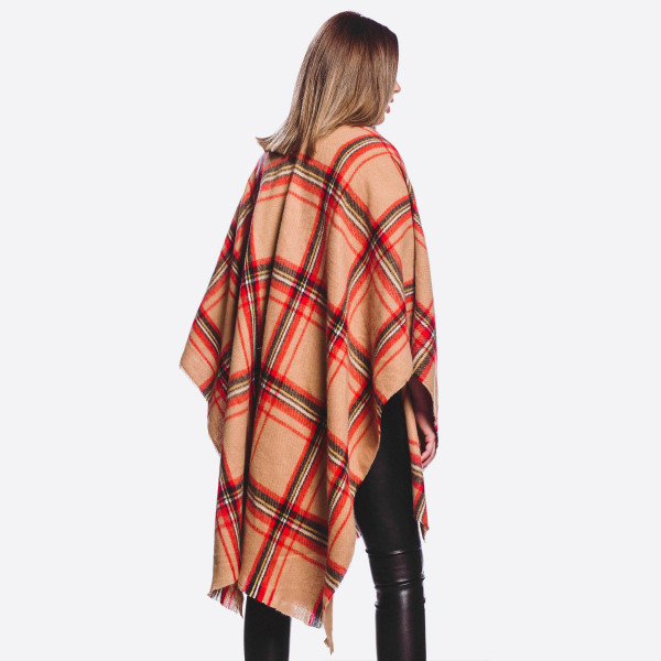 "Soft touch plaid print ruana/shawl.  - One size fits most 0-14 - Approximately 35"" L - 100% Polyester"