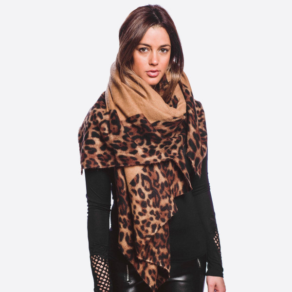 "Soft touch leopard print border vest.  - Approximately 34"" in length, longest length 47"" L - 20% Cotton, 80% Polyester"