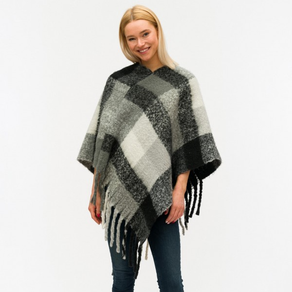 "Soft touch plaid poncho with fringes.  - One size fits most 0-14 - Approximately 40"" in length - 40% Acrylic, 60% Polyester"
