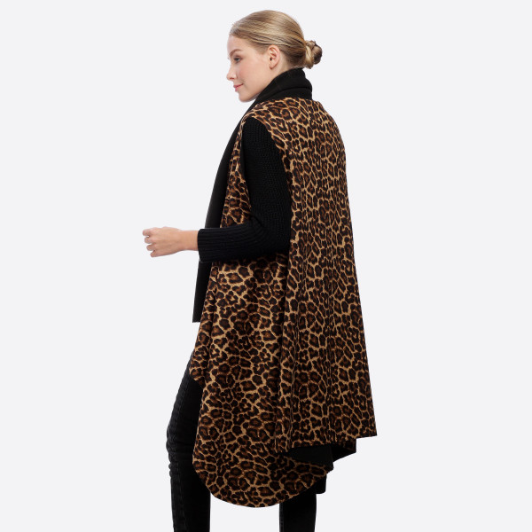 "Leopard print round vest.  - One size fits most 0-14 - Approximately 41"" L - 100% Polyester"