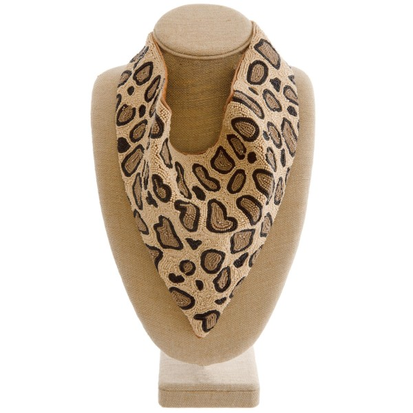 "Leopard print seed beaded scarf necklace.  - Heavyweight  - Button closure - Approximately 12.5"" W x 10"" L - Approximately 25"" in diameter - Lining 100% Cotton  - 75% Seed beads, 20% Cotton, 5% Acrylic stone"