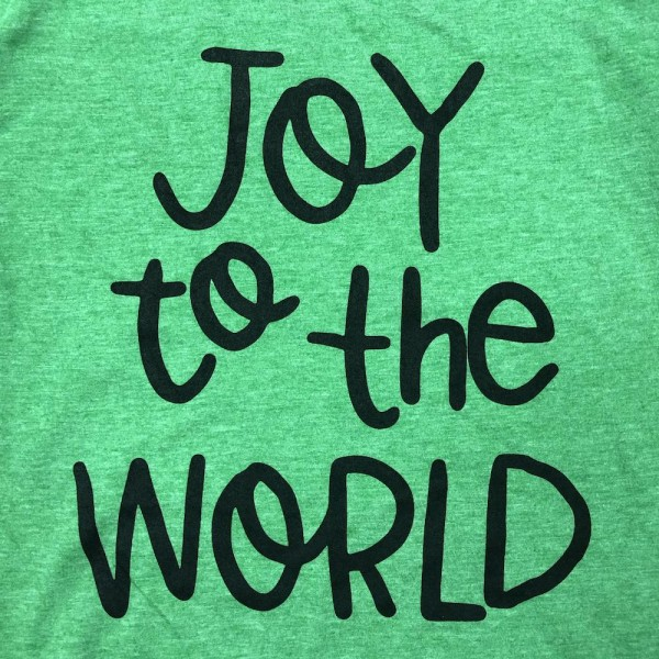 """Green Anvil Lightweight short sleeve """"Joy to the world"""" Christmas printed boutique graphic tee.  - Pack Breakdown: 6pcs / pack - 1-S / 2-M / 2-L / 1-XL - 65% Polyester, 35% Cotton"""